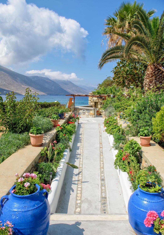 Levrossos Beach Apartments garden towards the beach